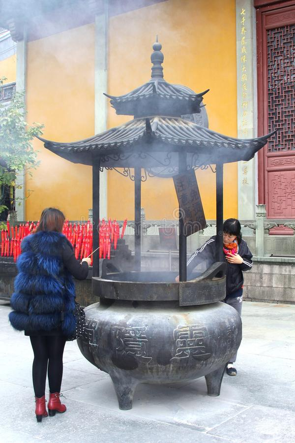 Female Buddhist prayers in the Lingyin temple, China royalty free stock photos
