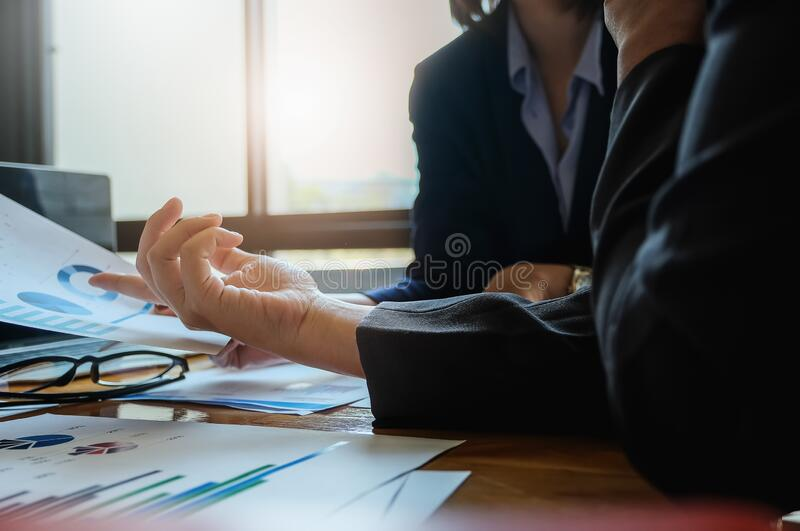 A women business consultant describes a marketing plan to set business strategies for women business owners. business budget stock photos