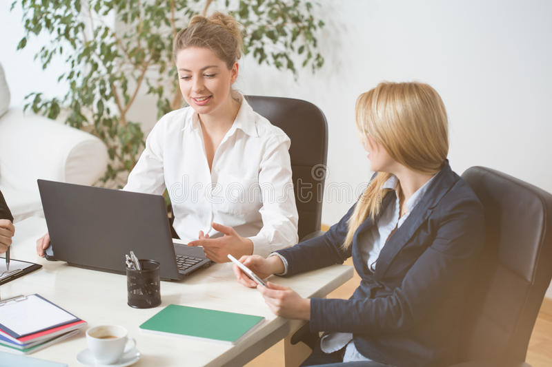 Women on business meeting. Two attractive women on important business meeting stock photo