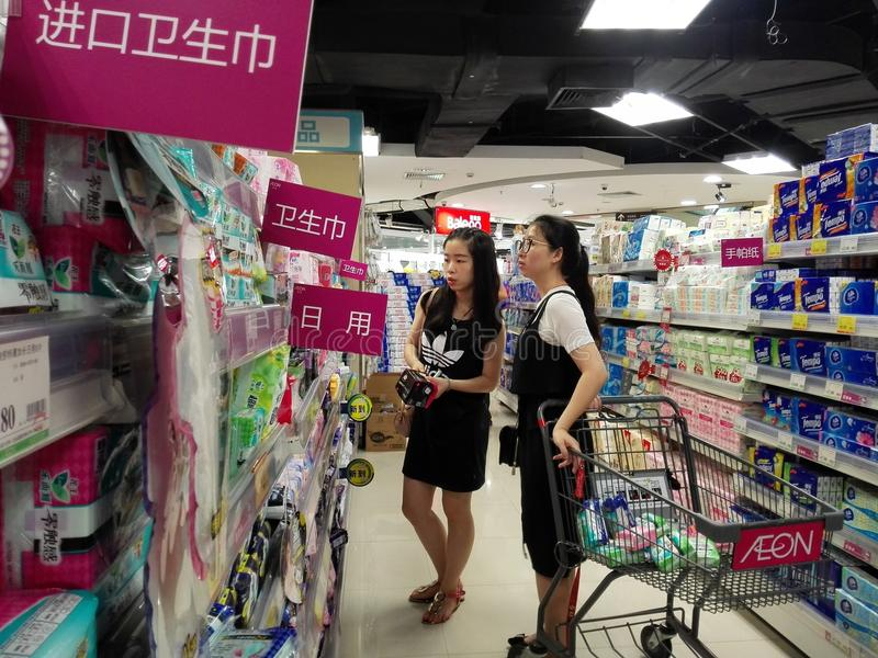 Women buy sanitary napkins at the mall. Two young women buy sanitary napkins at the mall. In Shenzhen, china stock photo
