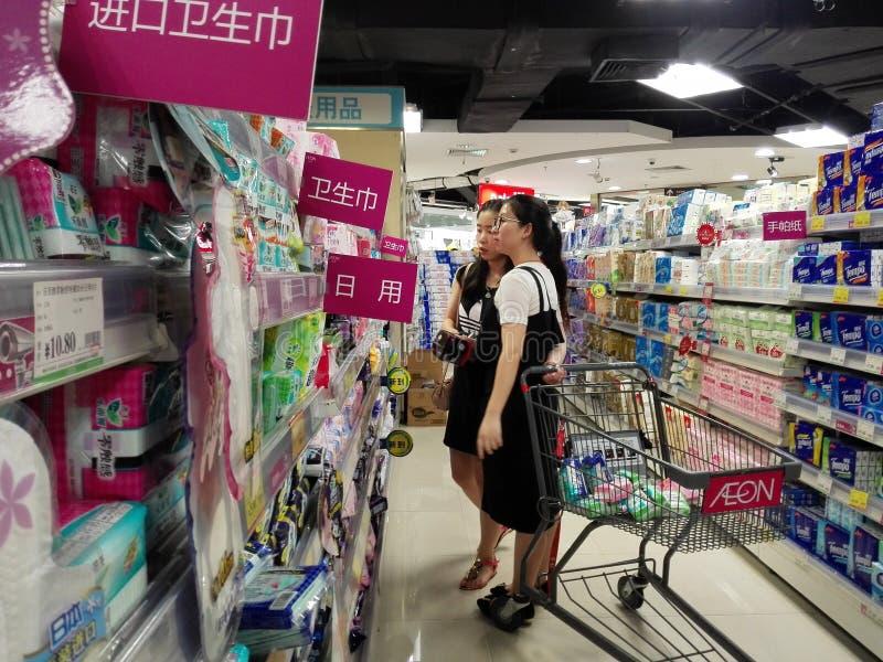 Women buy sanitary napkins at the mall. Two young women buy sanitary napkins at the mall. In Shenzhen, china royalty free stock photo