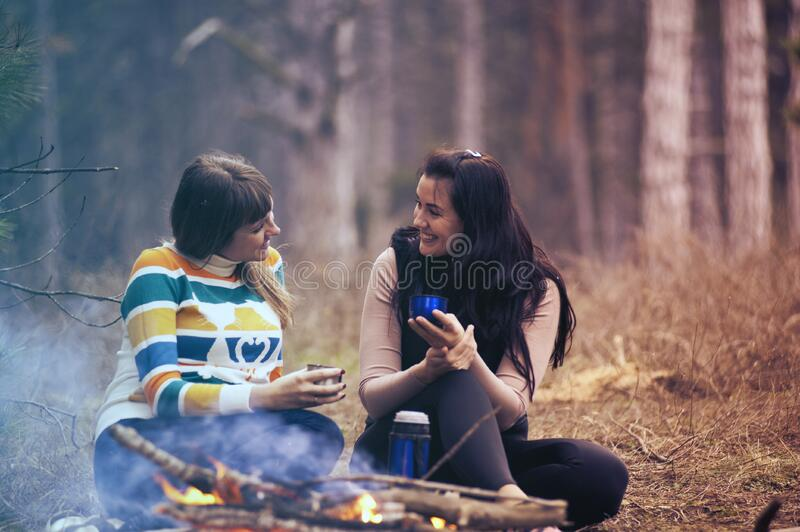 Women at campfire stock image