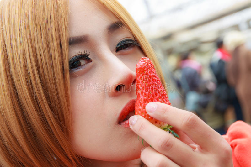 Women caressing Strawberry royalty free stock images