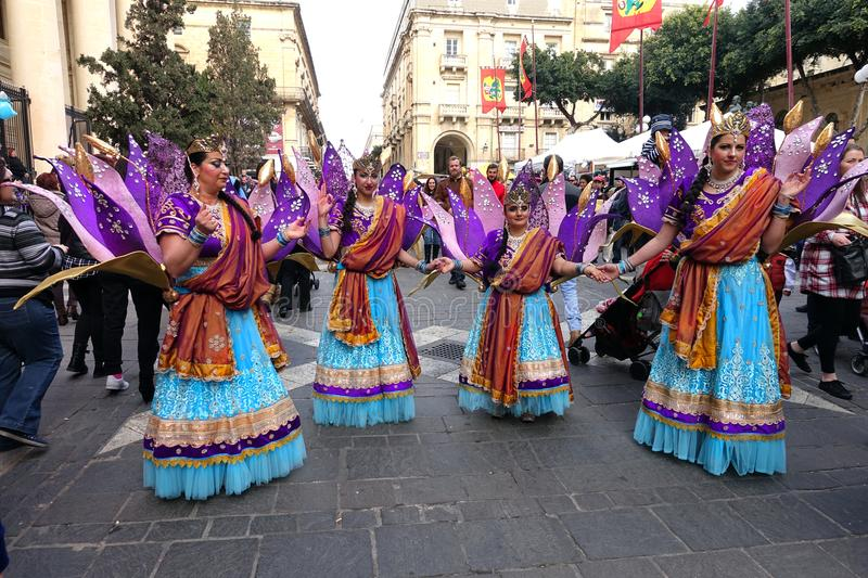 Women at Carnival Festival, Valletta, Malta. Group of women dressed in fanciful bright costumes pose on the streets of Valletta, the capital of Malta, during the stock photos
