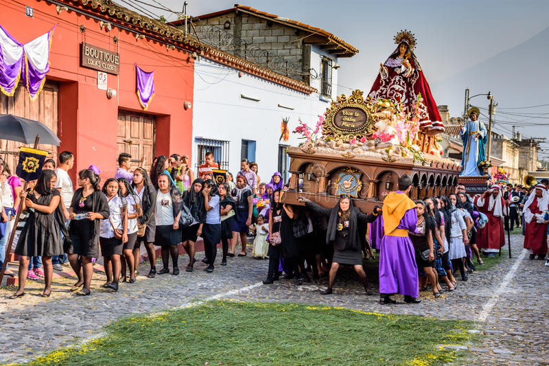 Women carry Vigin Mary, Antigua, Guatemala royalty free stock photography