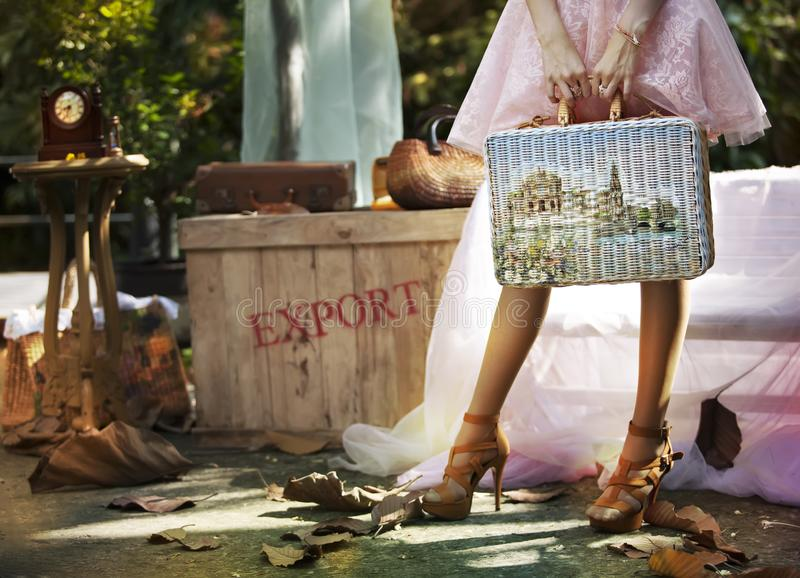 Women carrying luggage to travel stock photo
