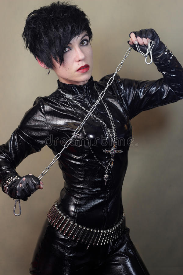 Women in cat suit. Young woman in black cat suit with chain stock images