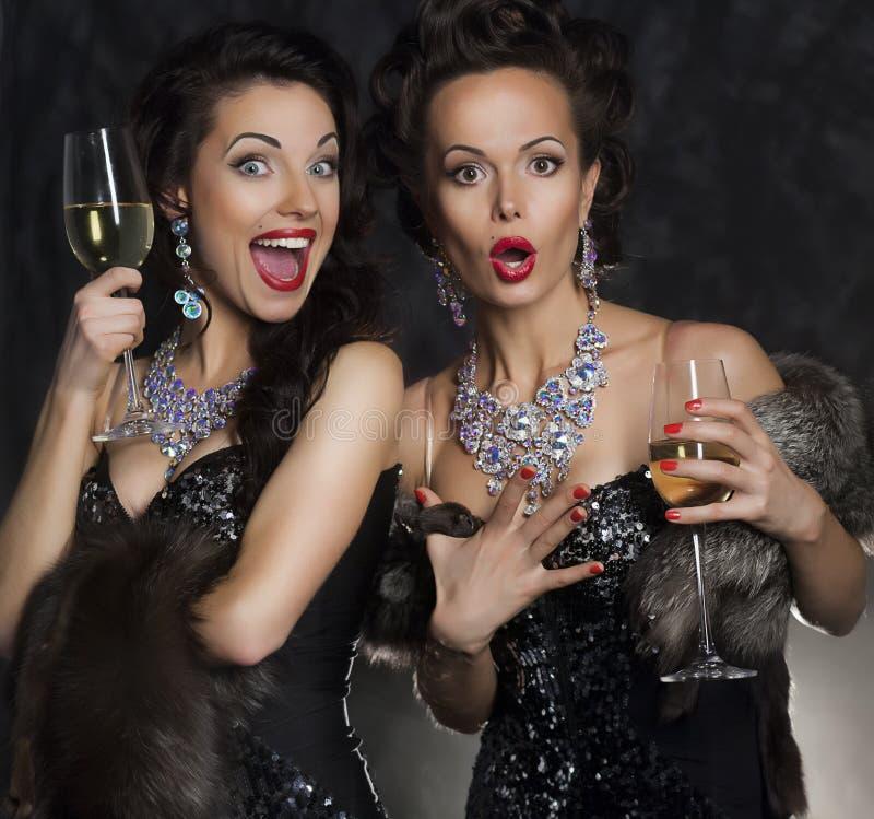 Women celebrating birthday in restaurant. Holidays stock photography