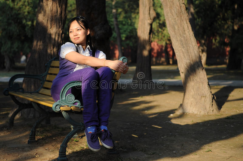 Download Women with chair stock photo. Image of asian, purple - 11526548
