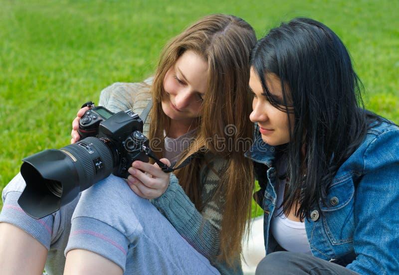 Women Checking Viewfinder Of Camera Stock Photo
