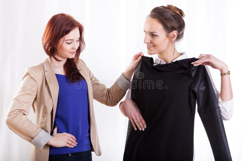Women choosing clothes together royalty free stock photo