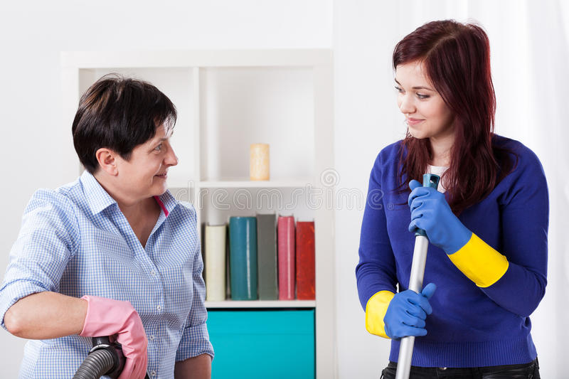 Women cleaning at house stock photos