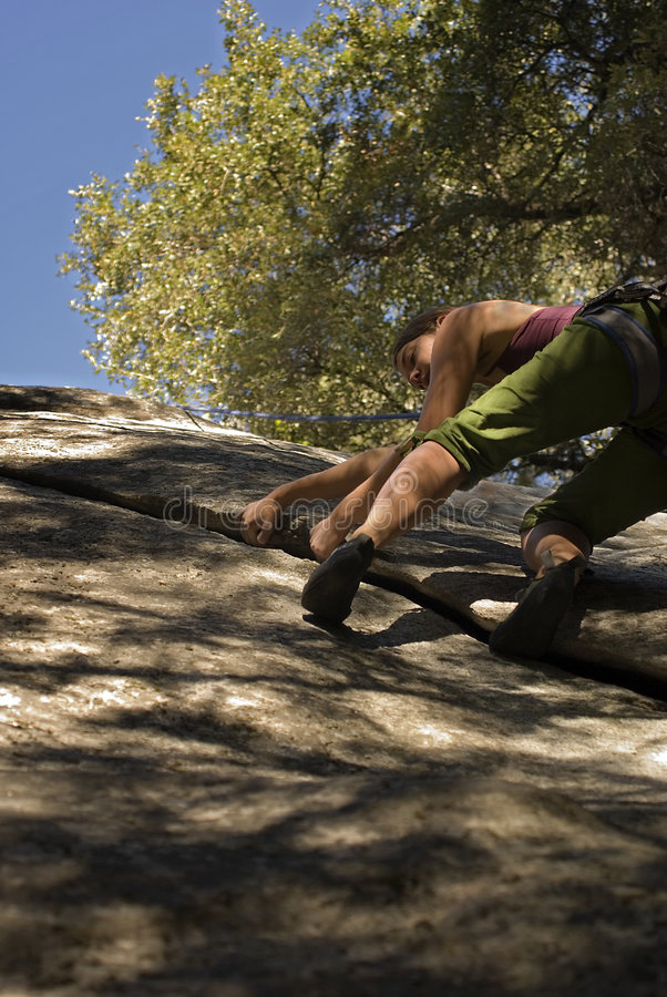 Women climbing in Yosemite. Yosemite National Park rock climbing route named Peruvian Flake. This route is near the Royal Arches stock images