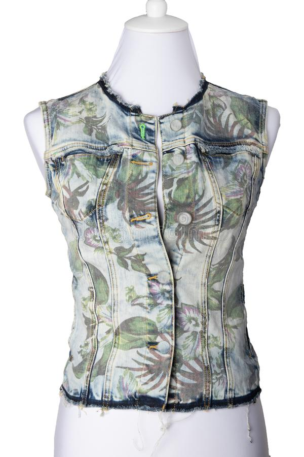 Women clothes. Sleeveless blue jeans vest or jacket for woman on royalty free stock images