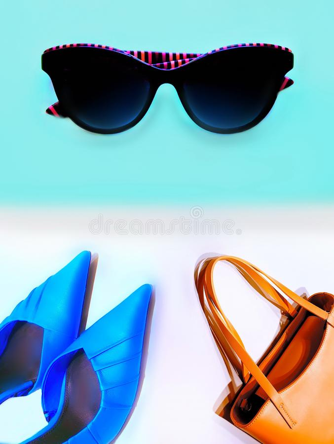 Women clothes travel accessories  shoes sunglasses handbag money wallet dress  hat blue red yellow black  gold  holiday summer sp stock images