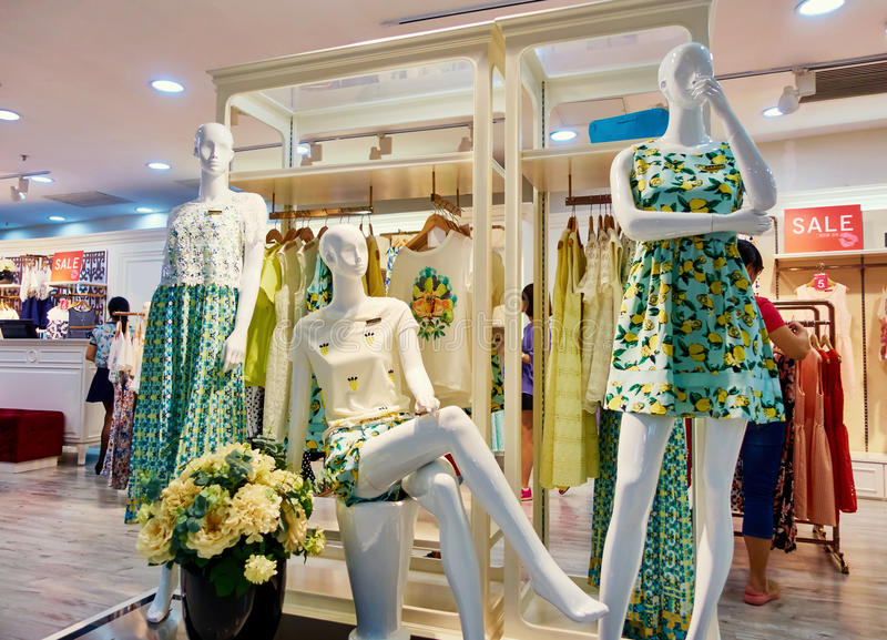 Clothing store fashion shop boutique women clothes. Interior of modern fashion boutique women clothing retail store with mannequins. Clothes shop with female stock photos