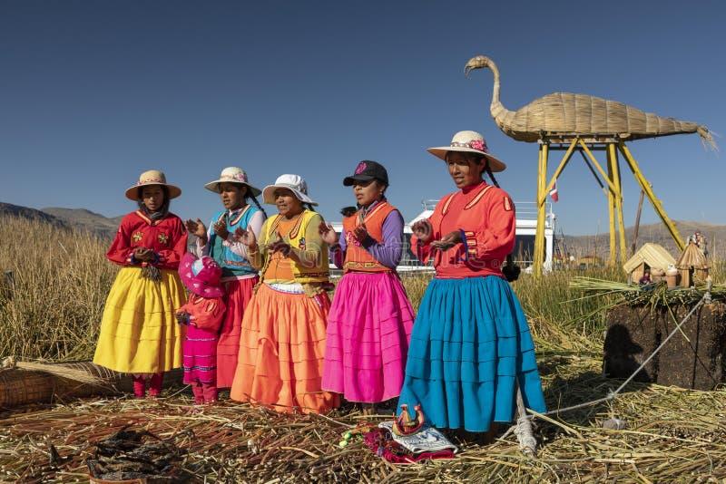Women in colorful clothes. Titicaca lake. Peru. stock photo
