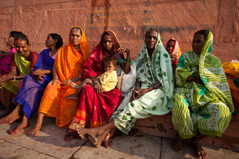 Women in colorful saris watch solar eclipse stock image