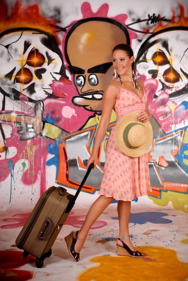 Women commuter graffiti wall stock image