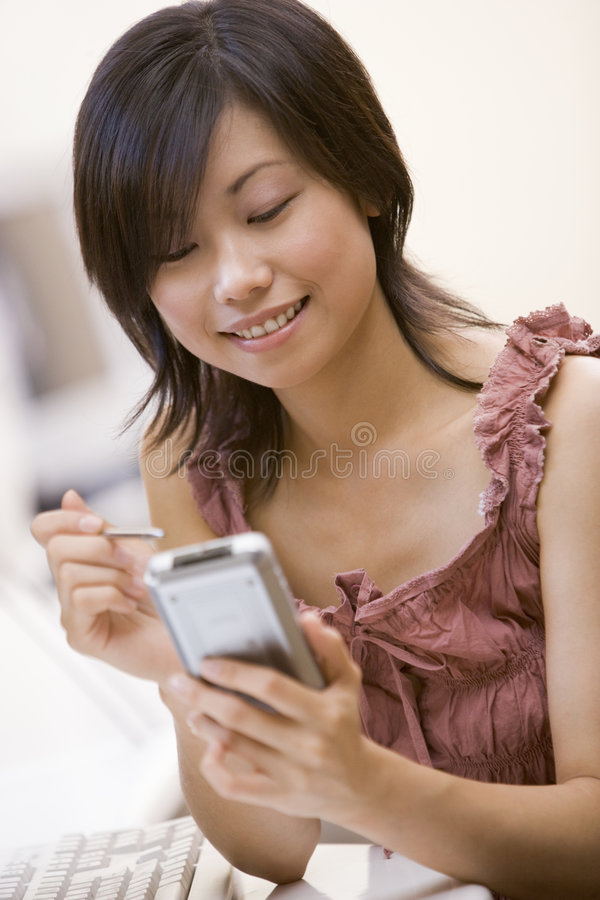Download Women By Computer With Digtial Personal Organsier Stock Photo - Image: 5707942