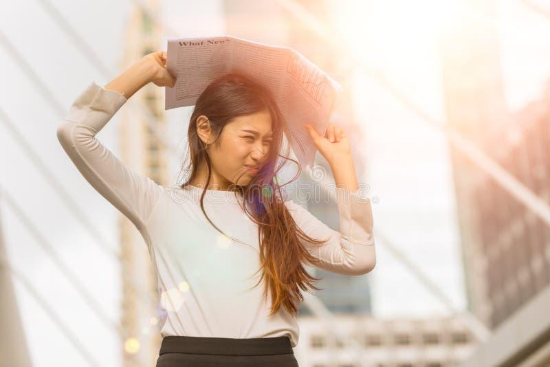 Women cover her face protect UV sunlight problem make dark spot and wrinkles damage her skin.  stock images