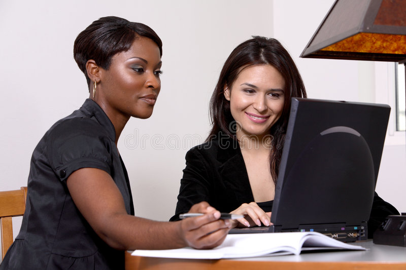 Women coworkers at computer stock images