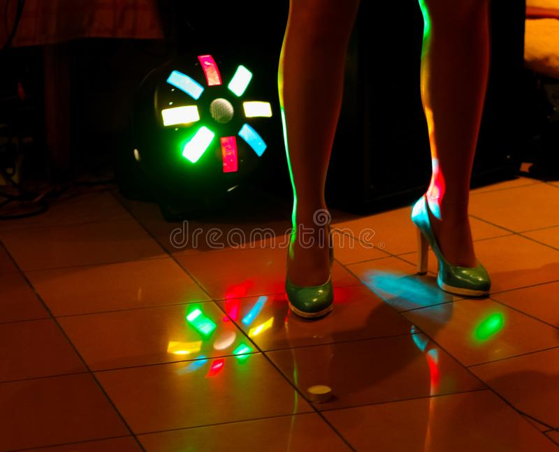 Women dance in a nightclub in the light of spotlights. royalty free stock images