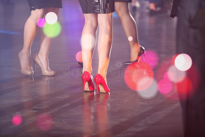 Women dancing at the party. Women with high heels dancing at the party, guests stock image