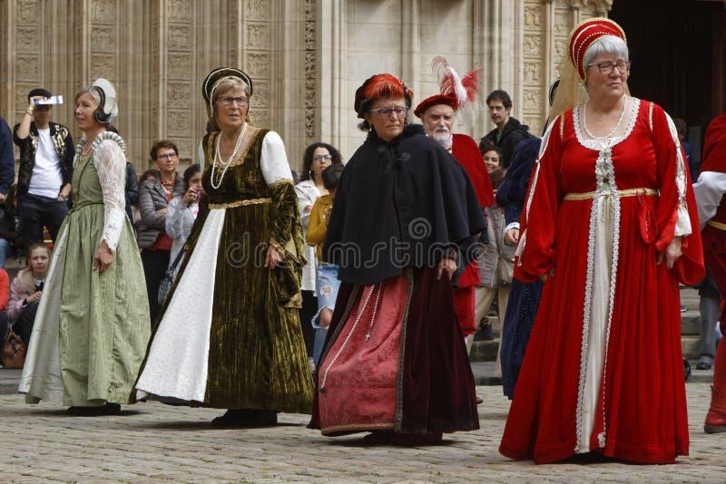 Women dancing on Place Saint-Jean during Renaissance Festival stock photography