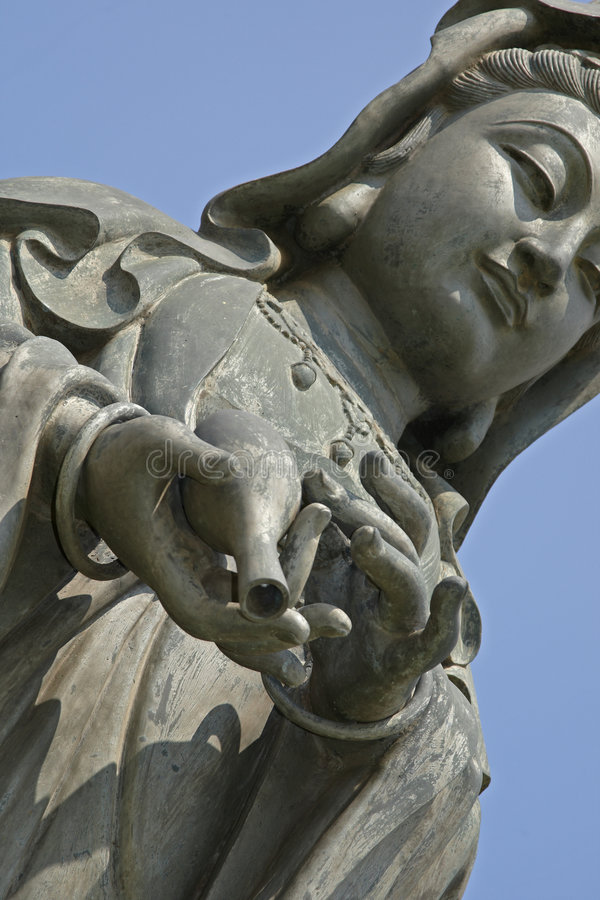 Women with delicate hands brings gift. Statue of woman in garden of Buddha Temple brings a gift stock images