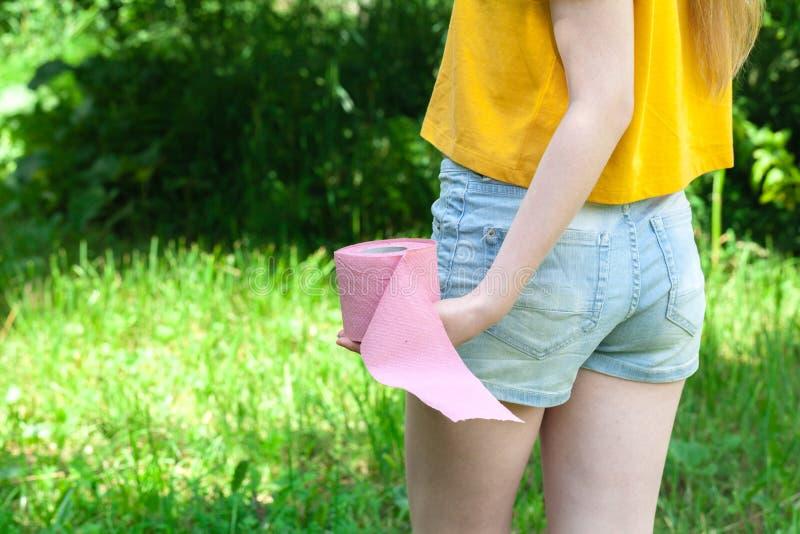 Women diarrhea in hand holding toilet paper stock photos
