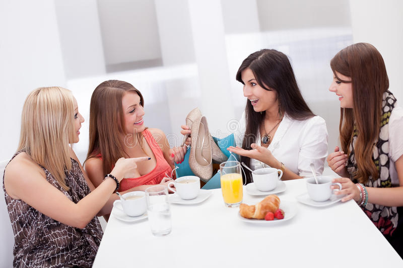Women discussing footwear together royalty free stock photo