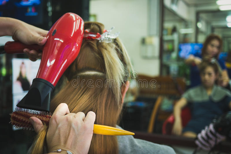Women do hair by skilled technicians stock photo