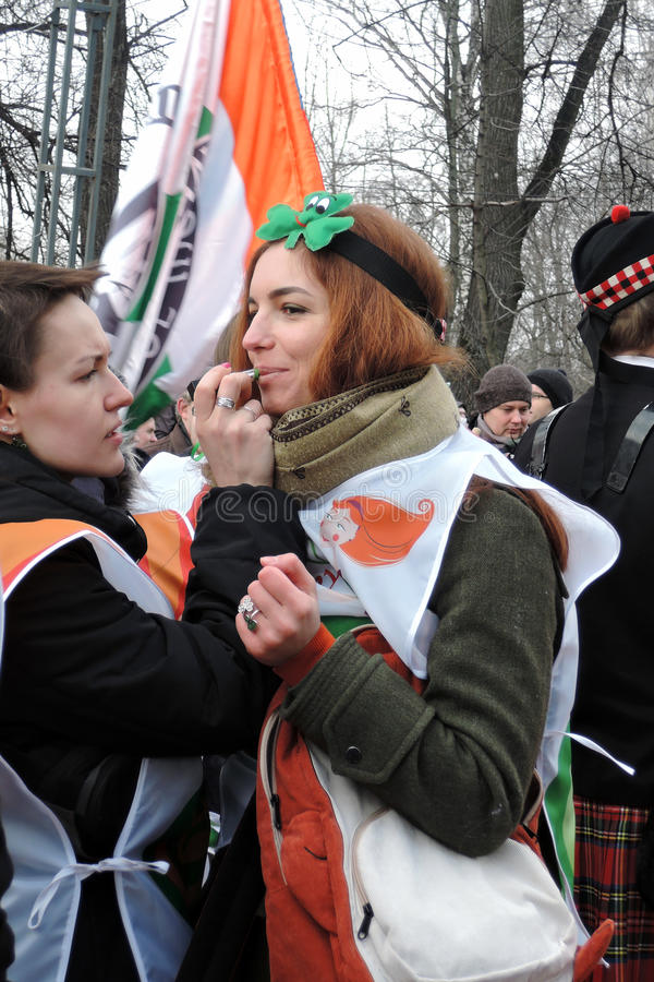 Women do make-up at Saint Patrick`s Day celebration in Moscow royalty free stock photography