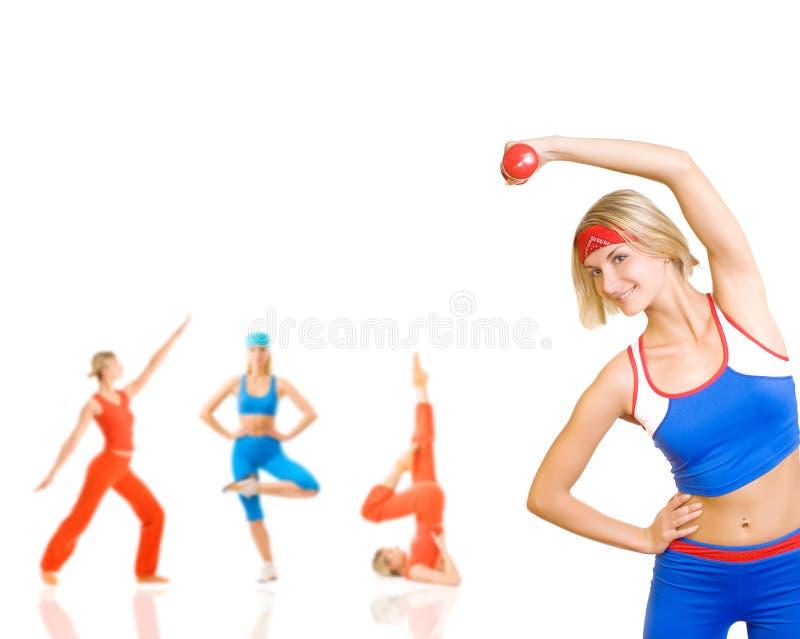 Women doing fitness exercise royalty free stock photo