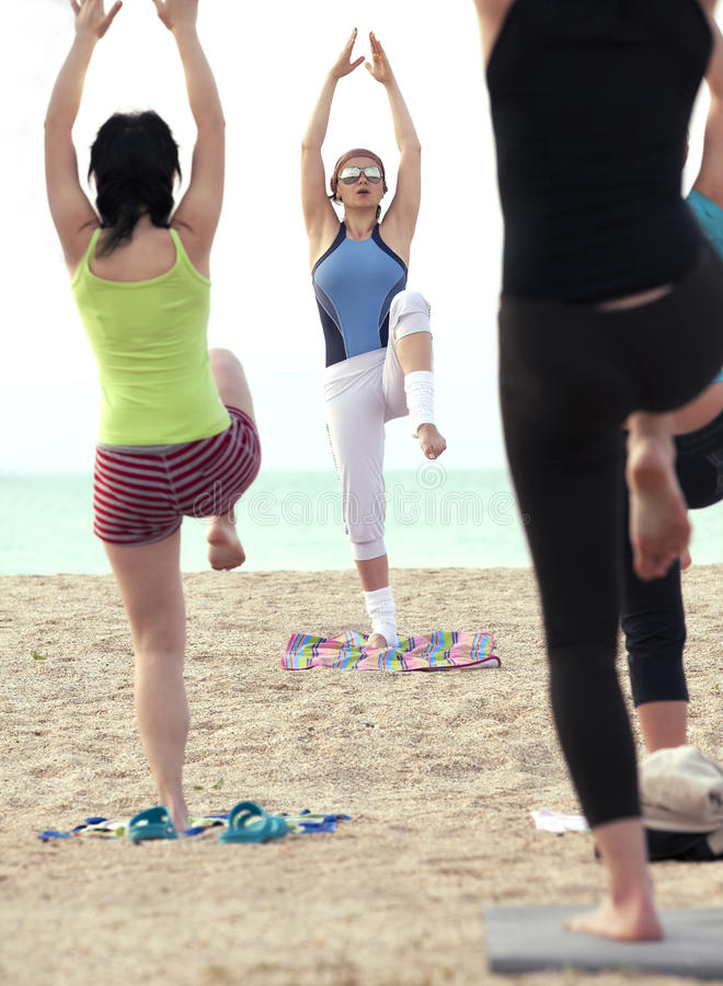 Download Women Doing Fitness Exercise On A Beach Stock Photo - Image: 17515854