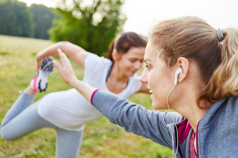 Women doing stretch exercise. For warm up royalty free stock photography