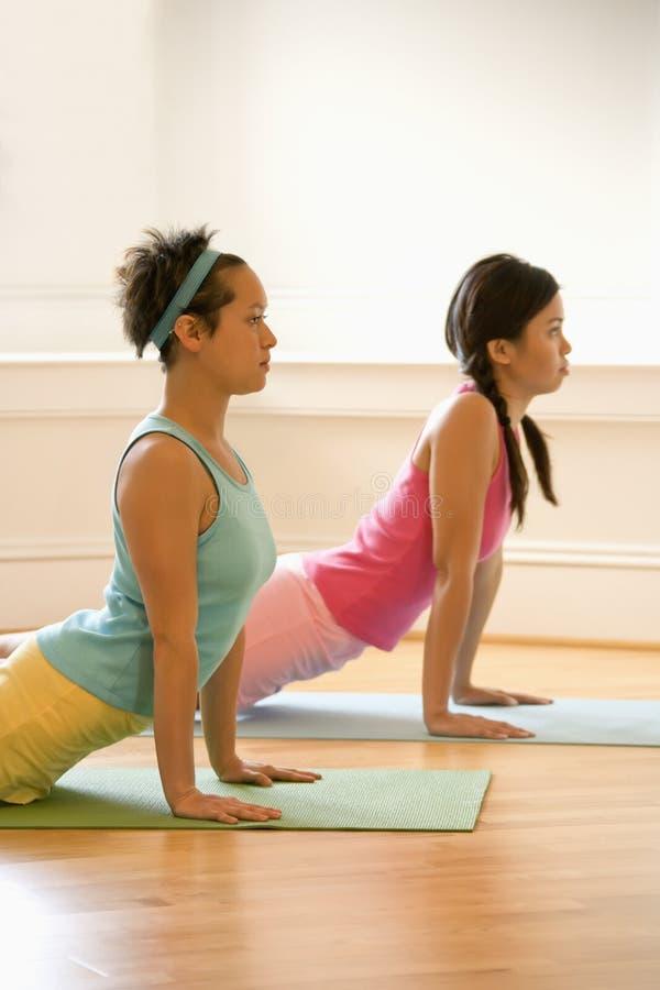 Women doing yoga royalty free stock photos