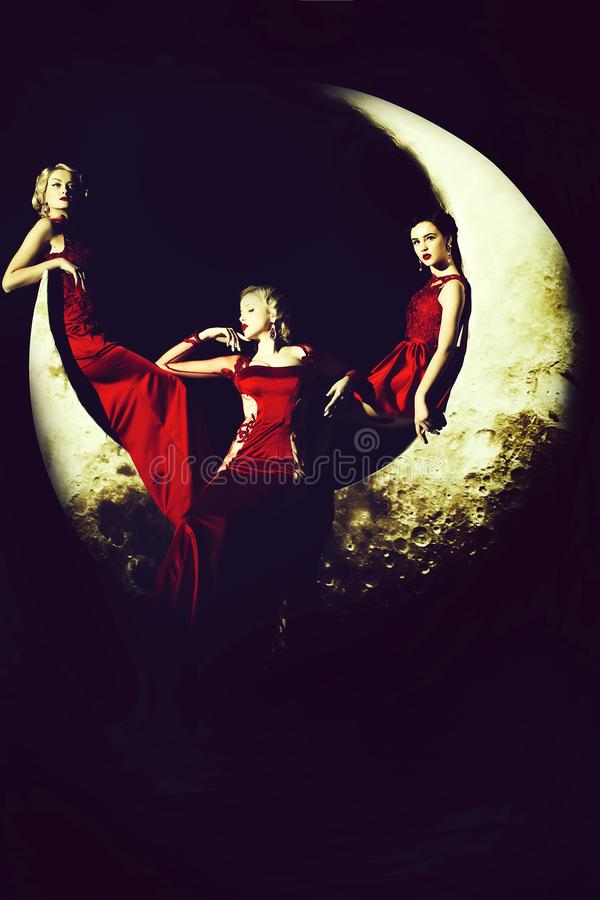 Women in dress on moon stock photography
