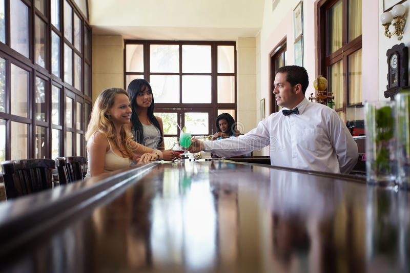 Women Drinking Cocktail In Pub Stock Photography