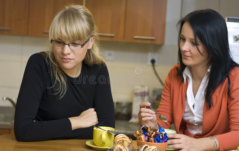 Women drinking coffee at home royalty free stock photos