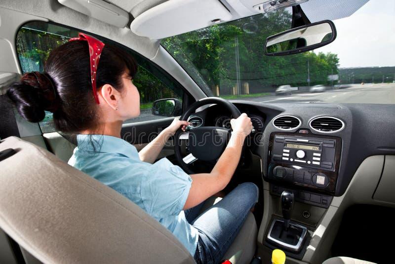Women driving a car royalty free stock photo