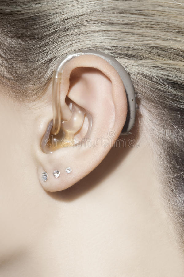Download Women ear with hearing aid stock image. Image of impaired - 39501805