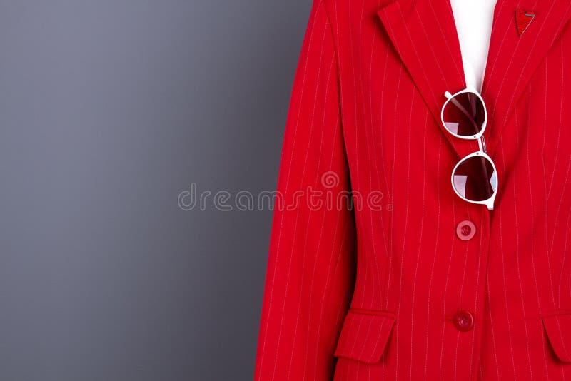 Women elegant blazer, sunglasses and copy space. stock image