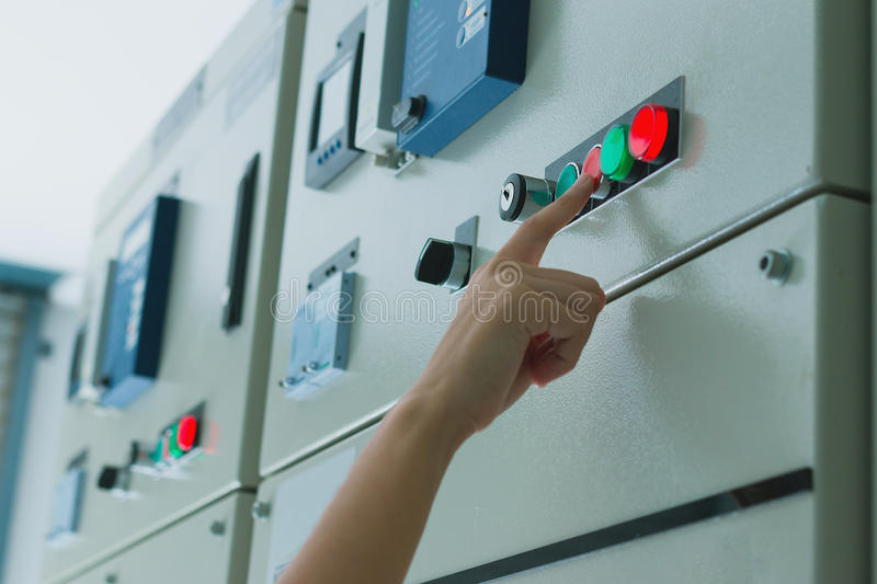 Women engineer working on checking and maintenance electrical equipment stock images