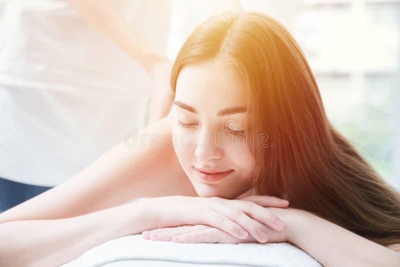 Women enjoy massage in spa feel relax eyes closed stock photos