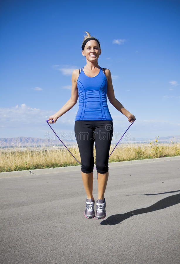 Download Women Exercising And Jumping Rope Stock Image - Image: 21530641