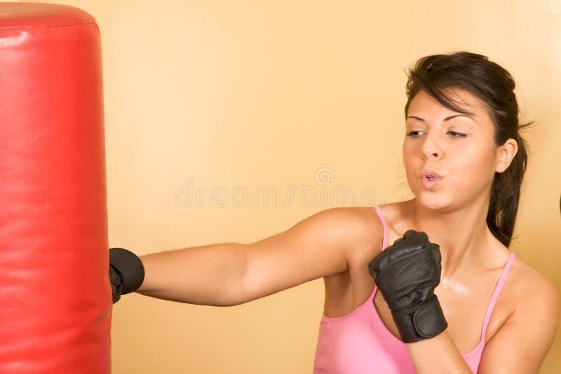 Women exercising on weightlifting machine royalty free stock image
