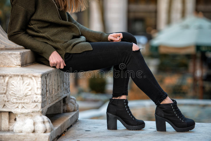 Women fall wear street style with black pants and sweater.  royalty free stock images