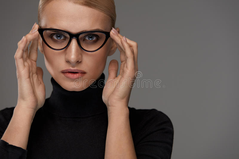 Women Fashion Glasses. Girl In Eyewear Frame, Stylish Eyeglasses. Women Fashion Glasses. Attractive Female In Black Cat Eye Design Optical Frame, Eyewear royalty free stock photography